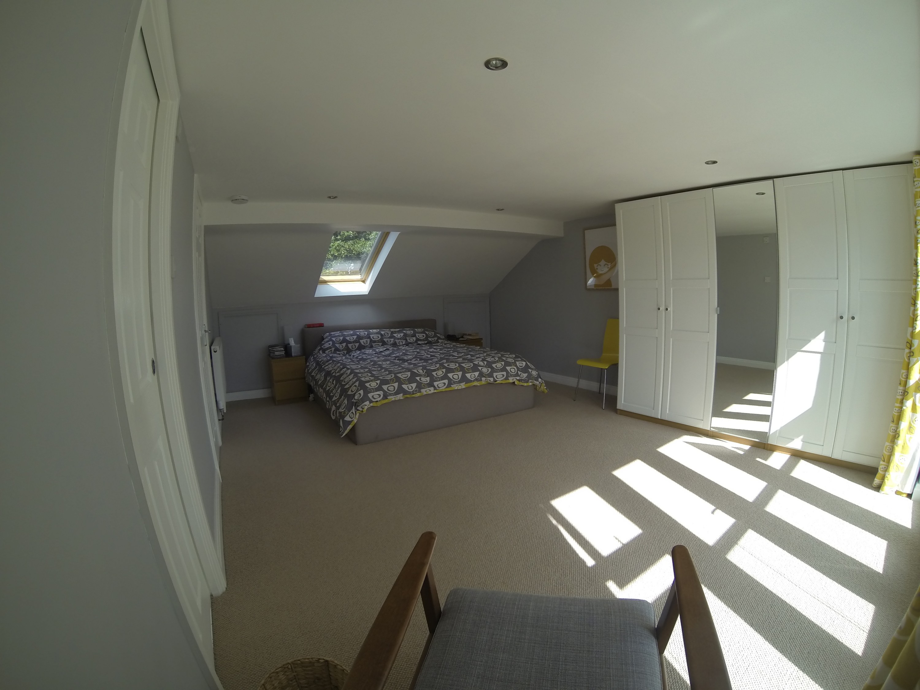 View of the Master bedroom facing the bed and velux window