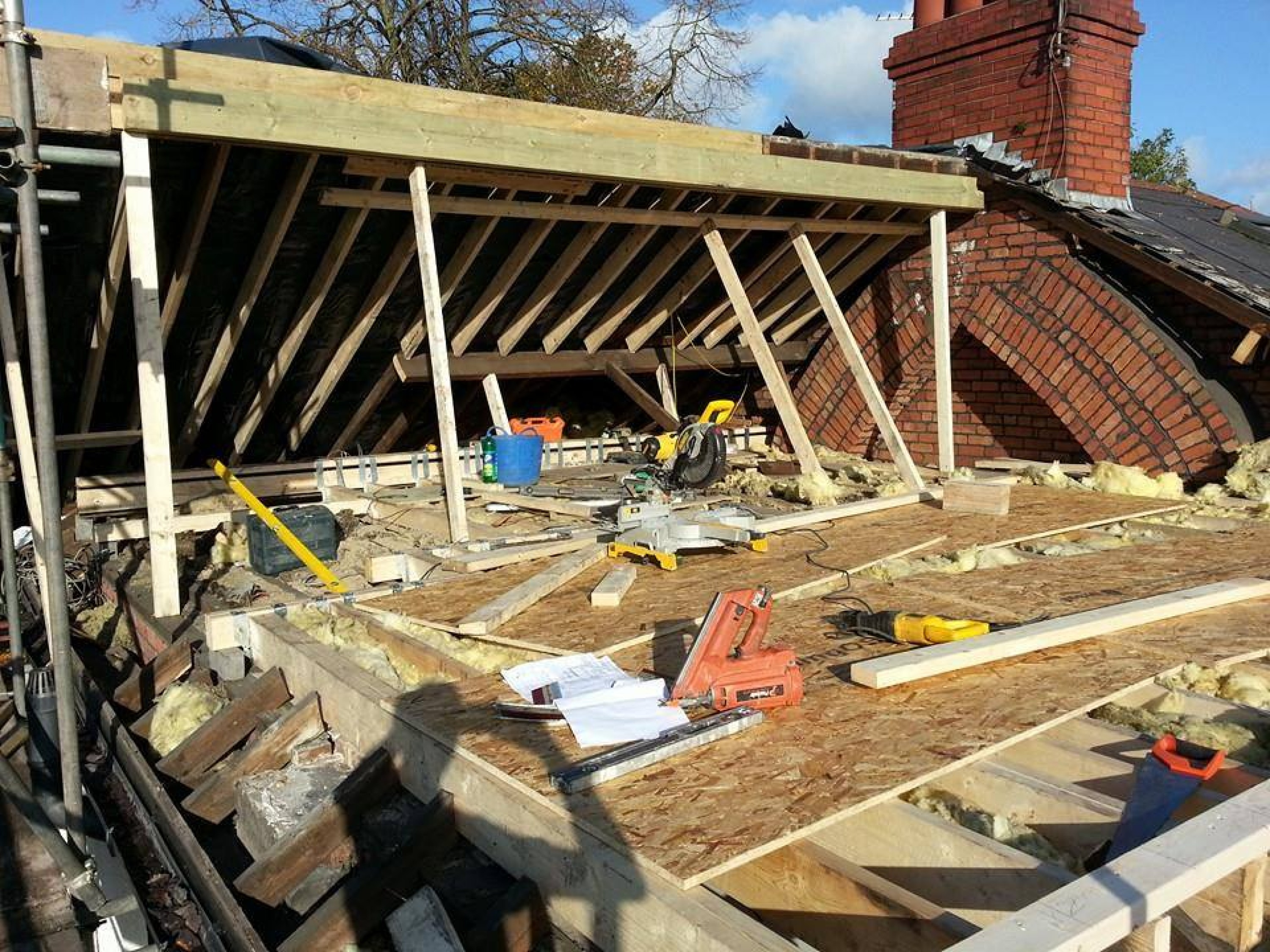 Taking advantage of a dry day by stripping the rear roof to install the new ridge beam and construct the rear dormer